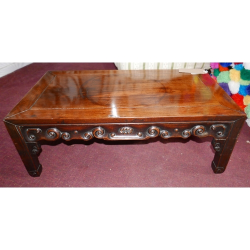 279 - A late 19th Century Chinese hardwood low table with carved frieze raised on square supports, H.28cm ...