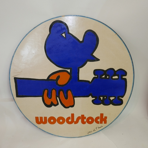31 - A vintage Woodstock adverting sign, signed by Gavin Du Plessis and dated 1994, Diameter 75cm...