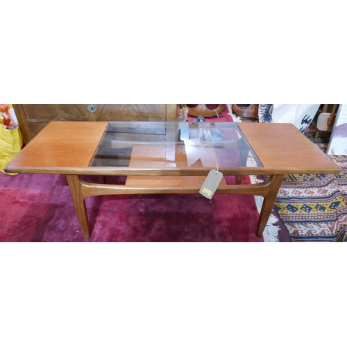 340 - A G Plan teak low table with central inset glass top over undertier shelf raised on square tapering ...