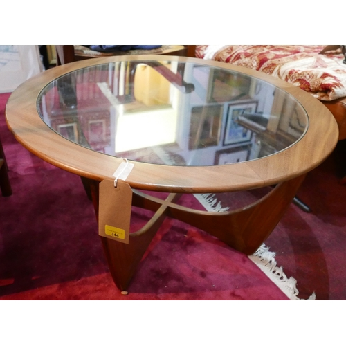 344 - A G plan Astro circular teak low table with inset glass top over cross stretchered supports, H.45cm ...