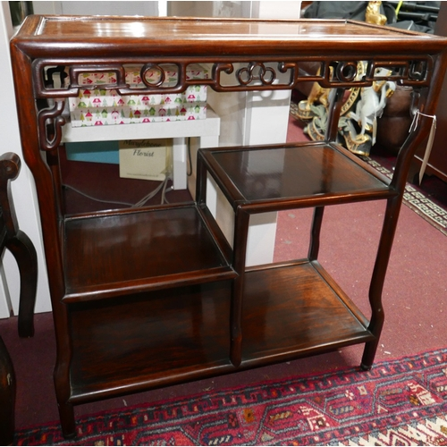 352 - An early 20th century Chinese hardwood shelf unit with pierced frieze over an arrangement of three s...