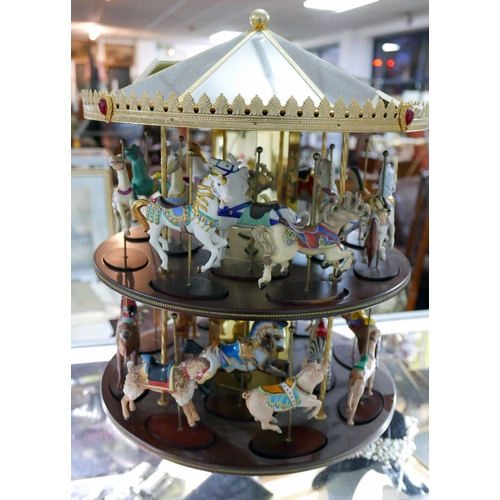 4 - A set of 24 Franklin mint 'treasury of carousel art' animals with spinning carousel display case and...