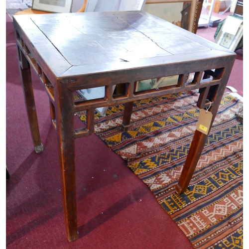 50 - A late 18th/early 19th century Chinese hardwood table, with carved frieze raised on shaped legs, H.8...