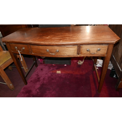 132 - A 19th century mahogany serpentine fronted writing table with three drawers raised on tapered legs j...