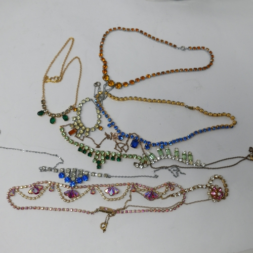 284 - A collection of nine vintage multi coloured diamante necklaces...