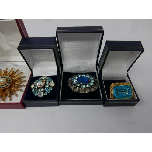 290 - A collection of six boxed vintage costume jewellery brooches inset with crystals in shades of blues ...