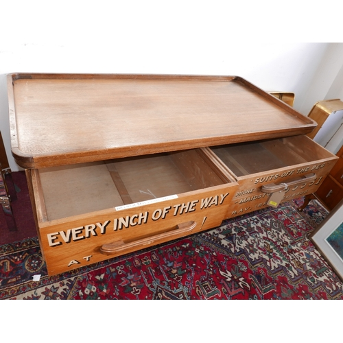 312 - An early 20th century oak tailors haberdashery counter with four drawers hand painted with lettering...