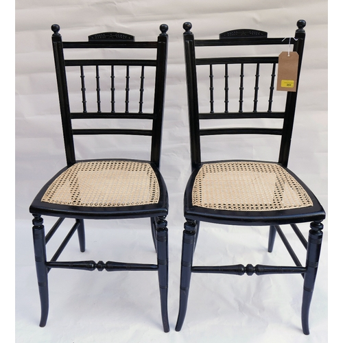 351 - A pair of Victorian aesthetic ebonized chairs with cane seats...
