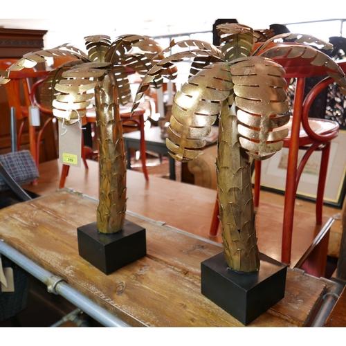 359 - A pair of Maison Jansen style gilt metal palm trees on black plinth bases, H.69cm (2)...