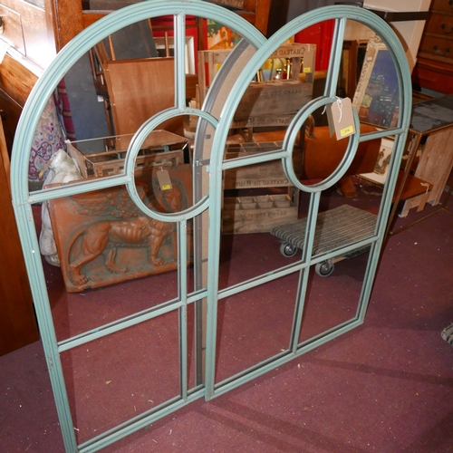 374 - A pair of large arched garden mirrors with green painted metal frames, H.122cm W.79cm (2)...