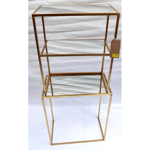 377 - A matched pair of contemporary gilt metal side tables with mirrored tops, one with under tier mirror...