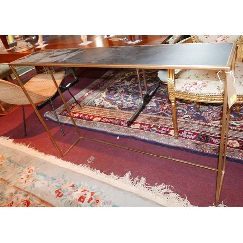 378 - A contemporary gilt metal console table, with a slate style top, H.81cm W.119cm D.25cm...