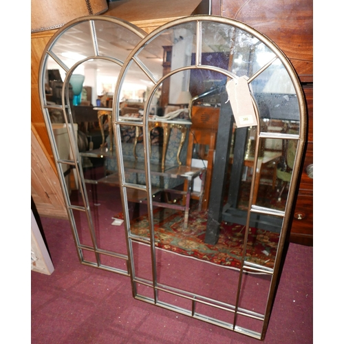 380 - A pair of contemporary arched garden mirrors with gilt metal frames, H.107cm W.54cm (2)...