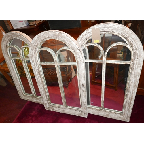 381 - A set of three contemporary arched garden mirrors with distressed wooden frames, H.94cm W.55cm (3)...