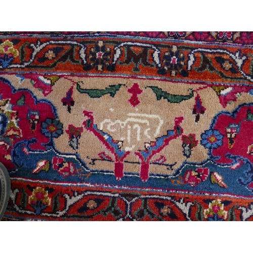 22 - A signed  North East Persian meshad carpet repeating spandrles and foliot motifs all over on an ivor...