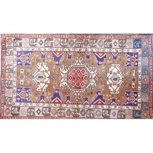 24 - A North West Persian Nahawand rug. Triple pole medallion with repeating geometrical motifs on a came...