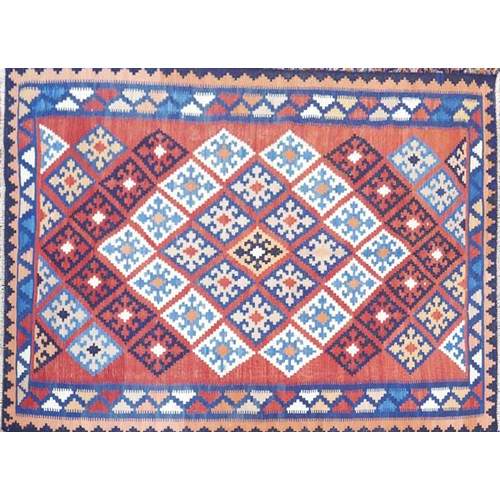 26 - A South West Persian Qashgai kilim. Repeating geometrical motifs, all over on a rouge field within s...