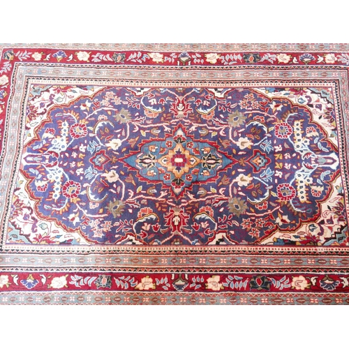 38 - A North West Persian mahal carpet. Double pendent medallion with repeating spandrles and petal motif...