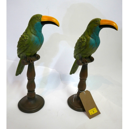 2 - A pair of painted composite parrots on stands, H.45cm (2)...