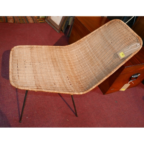 388 - A wicker conservatory chair raised on wrought iron legs...