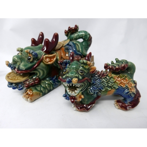 368 - Two Chinese ceramic dogs of Fo, the larger one having ceramic Feng Shui coins in mouth and back, L.2...