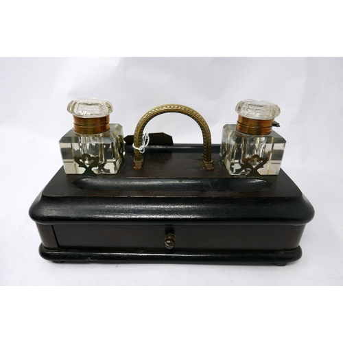 370 - A Victorian oak inkwell, with two glass and brass mounted inkwells, having single drawer, with carry...