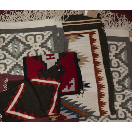 95 - A pair of grey Zapotec rugs, a similar runner and 2 smaller similar rugs...