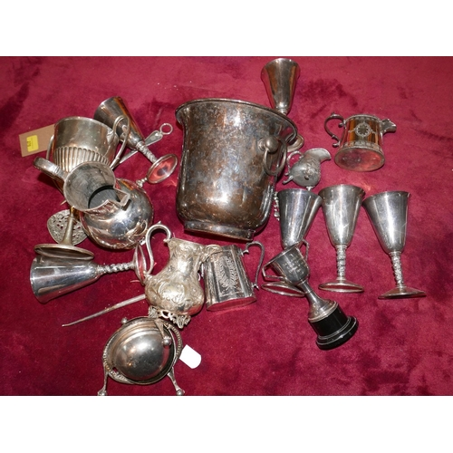 270 - A collection of silver plated items to include a wine cooler, trophies, jugs and goblets...