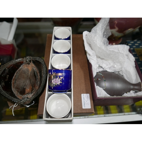 79 - A resin model of a Chinese libation cup and 3 boxed sets of sake cups and flagons...
