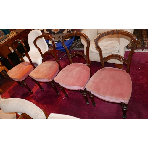 153 - A set of four Victorian aesthetic mahogany dining chairs with pink velour upholstery...