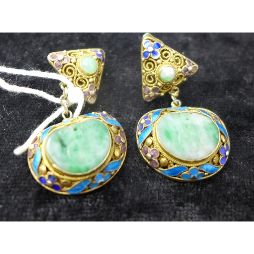 1007 - A boxed pair of antique Chinese green jade and enameled clip on earrings, each earring composed a tr...