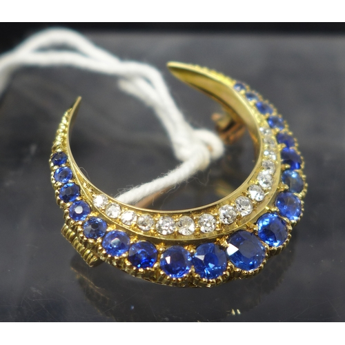 1008 - A Victorian 18ct yellow gold sapphire and diamond crescent brooch set with nineteen graduated round ...