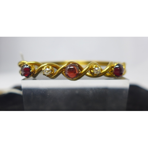 1010 - A Victorian 15ct yellow gold bracelet set with three cabochon garnets and two diamonds, 11.5g, 6cm d...