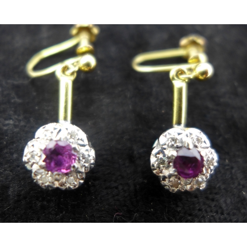 1015 - A pair of antique 18ct yellow gold and platinum, ruby and diamond cluster drop earrings, the cluster...