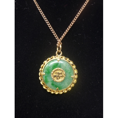 1016 - An antique Chinese 9ct yellow gold, green jade and old-cut diamond pendant on 9ct yellow gold chain....