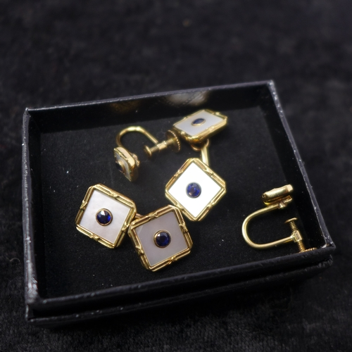 1018 - An Art Deco yellow gold, sapphire and mother of pearl dress-set, to include a matching pair of cuffl...