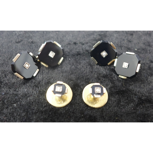 1020 - An Art Deco yellow gold and platinum onyx and diamond dress-set, to include a matching pair of cuffl...