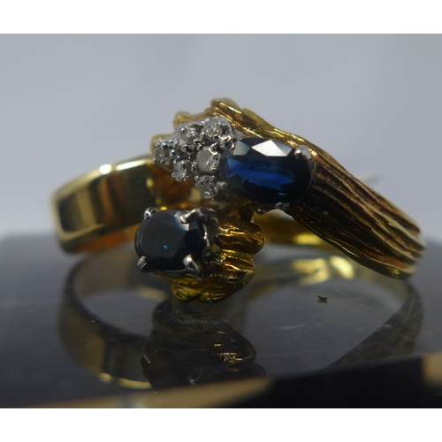 1027 - Two antique 9ct yellow gold rings, to include a double sapphire and diamond example and a solid gold...