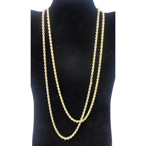 1028 - Two long 9ct yellow gold rope-twist chain necklaces. Total weight: 30.4g...