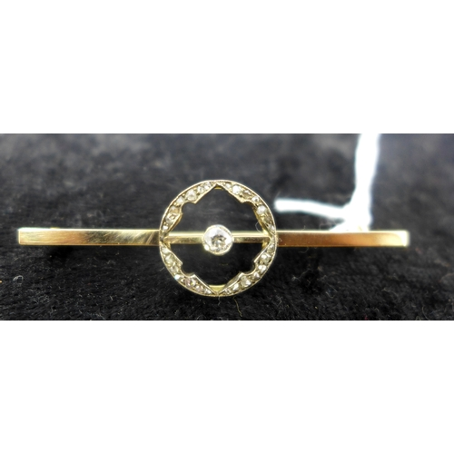 1029 - Antique 9ct yellow gold and diamond circular bar brooch, set with a central collet-set diamond and s...