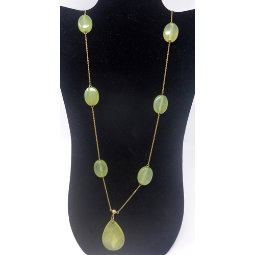 1031 - An antique 9ct yellow gold chain necklace set with seven polished green agate beads, 60g, L: 108cm...