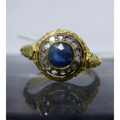 1032 - A Georgian 18ct yellow gold old-cut diamond and sapphire cluster ring, the central round faceted sap...