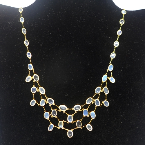 1035 - A 14ct yellow gold and natural moonstone cabochon chandelier necklace set with fifty-two oval moonst...