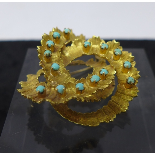 1036 - An 18ct yellow gold Italian brooch of textured spiral form, inset with fifteen turquoise cabochons, ...