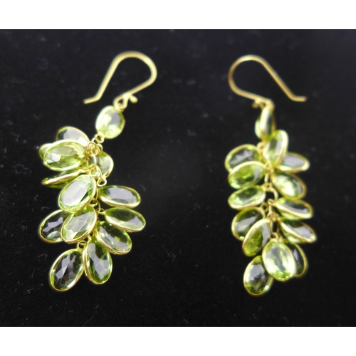 1039 - A pair of 14ct yellow gold peridot grape-cluster earrings set with twelve natural faceted peridot st...