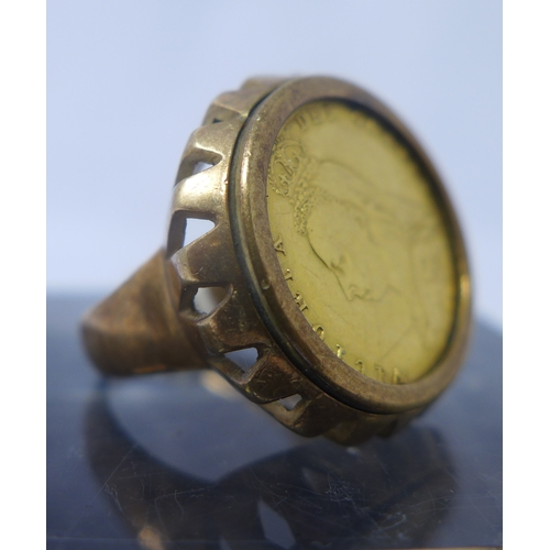 1040 - A gold 1897 Victorian half sovereign set in a 9ct yellow gold ring mount. 10.3g...