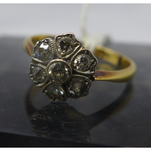 1044 - An cased antique 18ct yellow gold and diamond cluster ring in the form of a flower head, set with se...