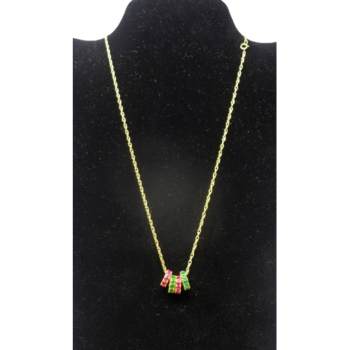 1046 - A 9ct yellow gold chain suspended with four 18ct yellow gold disc pendants, two of which studded wit...