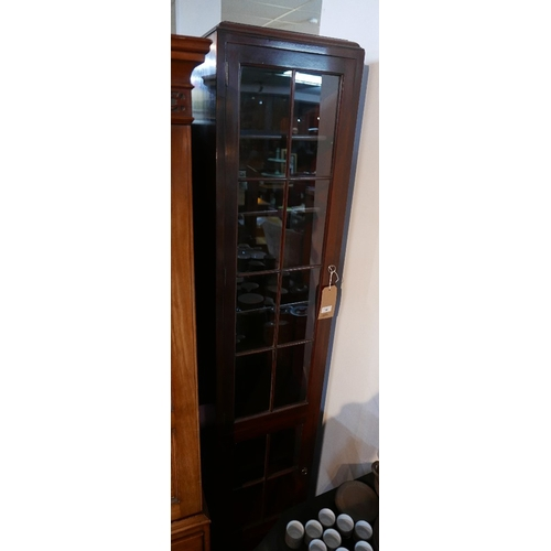 202 - A narrow mahogany bookcase, with two astragal glazed doors, H.190 W.41 D.30cm...