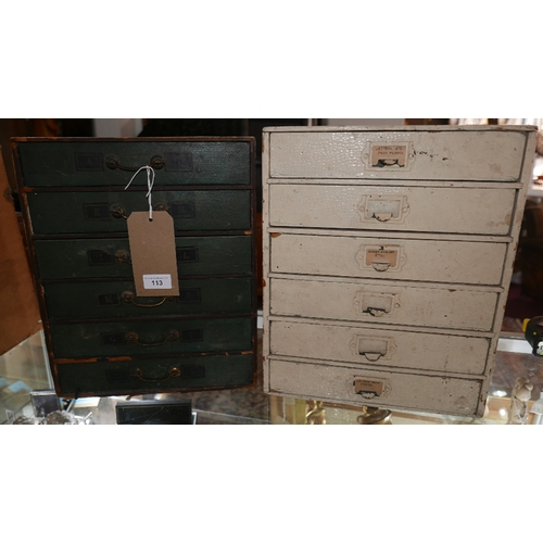 113 - Two early 20th century cardboard chests of six drawers...